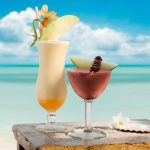 Cocktail on the background of the ocean desktop wallpaper