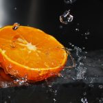 Orange under the drops of water desktop wallpaper