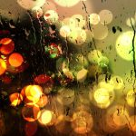 City lights through wet glass desktop background