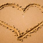 Heart-shaped picture on the beach