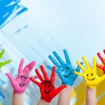 Children's hands in paint with smiles wallpaper