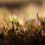 Soap bubble on a blade of grass desktop background