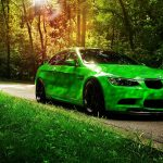 Green HD car wallpaper driving on the road