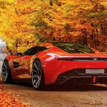 Red Aston Martin HD Wallpaper on Fall Foliage Highway