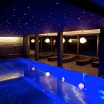 Indoor pool, lounge chair, illuminated widescreen wallpaper