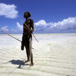 Fisherman on the Beach at Low Tide, Zanzibar, Tanzania wallpaper
