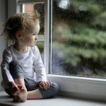 Little girl cute child wallpaper watching the rain in front of the window