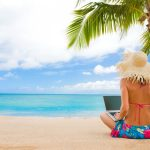 Girl on the beach with a laptop desktop wallpaper