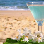 Blue cocktail on the beach with flowers desktop wallpaper