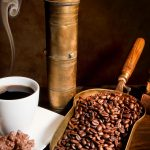 Cup of coffee and coffee beans wallpaper