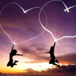 Couple jumping with hearts wallpaper