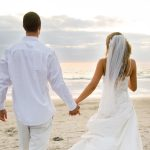 Newlyweds on the beach wallpaper
