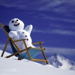 Snowman on a lounger desktop wallpaper