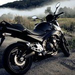 Black motorcycle in the field hd wallpaper