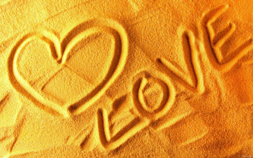 Inscription I love you in the sand wallpaper