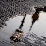 Reflections of a lantern in a puddle hd wallpaper