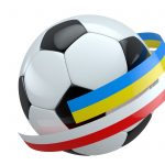 Flags of Poland and Ukraine around the ball