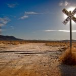 Railway crossing in the desert desktop wallpaper