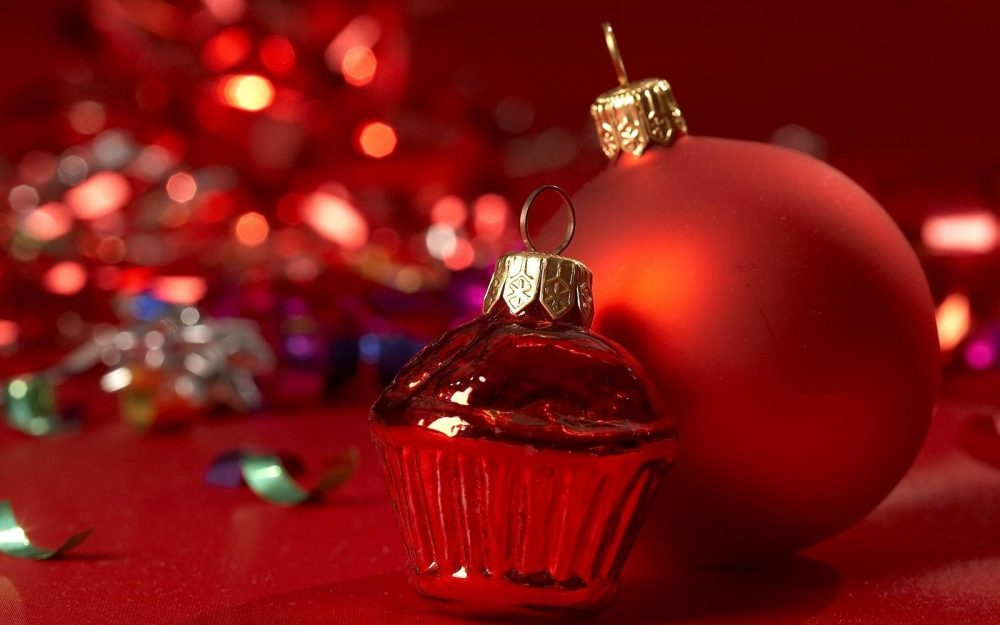 christmas toys, red background, close-up