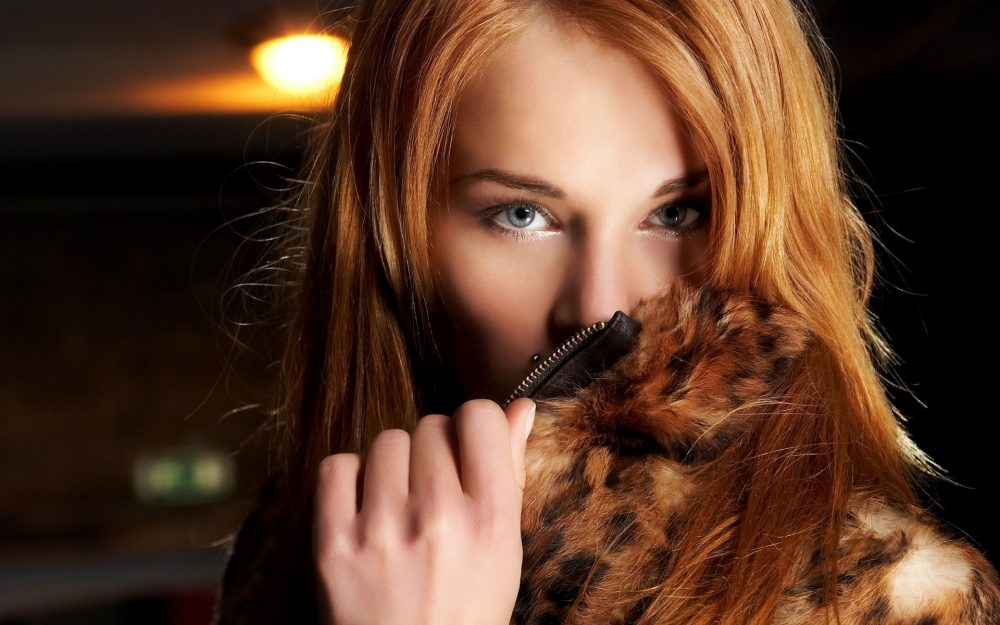 Red-haired girl in a fur coat desktop background