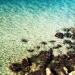 Small surf, rocks, shallow water