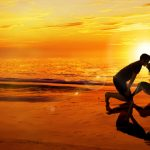 Romantic happy couple at sunset wallpaper