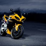 Yellow motorcycle on the night road