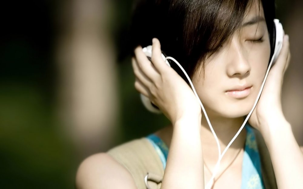 Kwai Lun Mei wearing headphones wallpaper