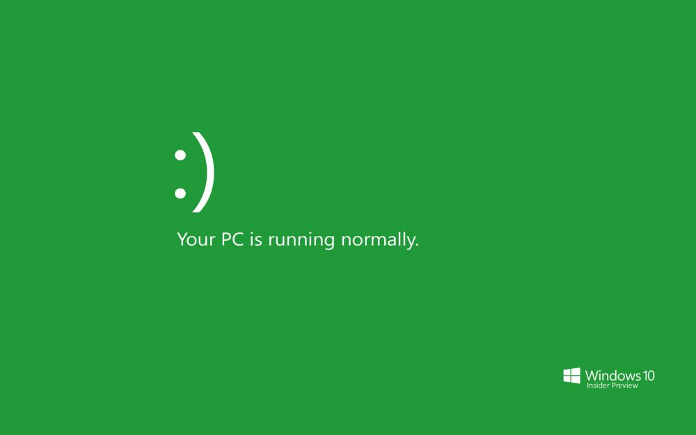Smile, your computer is running, simple green background wallpaper