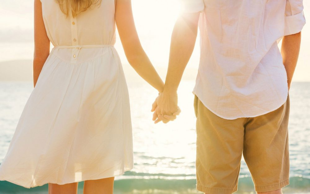 European and American couple holding hands background wallpaper