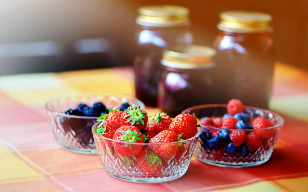 Strawberries, blueberries, blackberries, raspberries, bowls