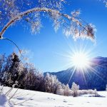 Blue sky and sunshine winter snow desktop wallpaper