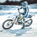 Snow, speed, motorcyclist