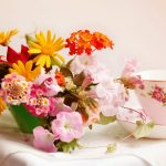 Flowers, cups, napkins, beautiful wallpaper