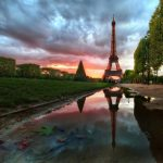 Reflection of the eiffel tower in a puddle