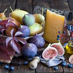 Cheese, figs, figs, blueberries, grapes, pears