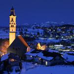 The bell tower, snow, evening