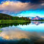 Water smooth surface, sky, clouds, mountains, brightly, lake