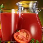 Tomatoes, jug, a glass of tomato juice
