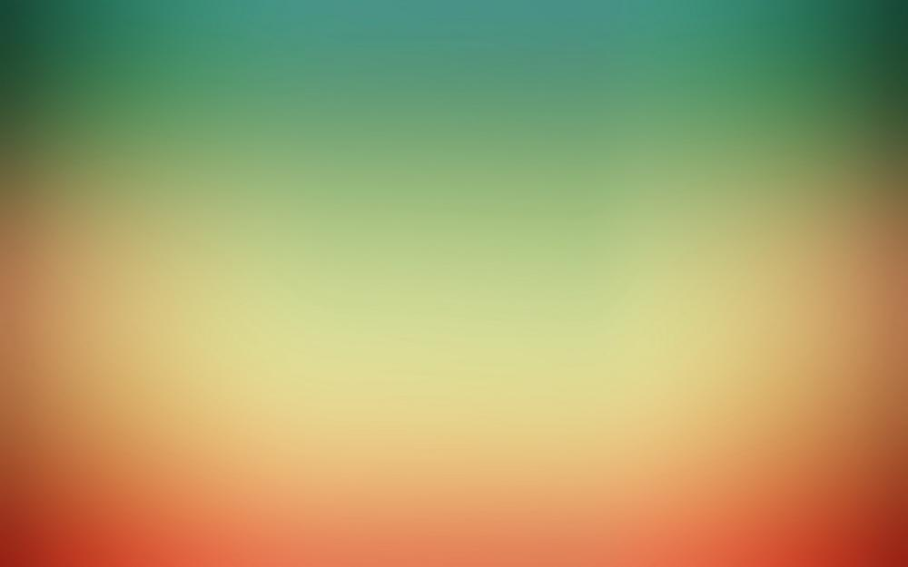 Orange-green blur desktop wallpaper