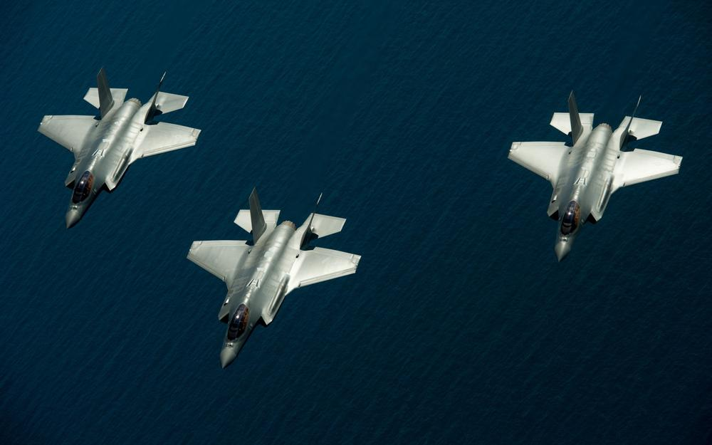 Three fighters over the sea