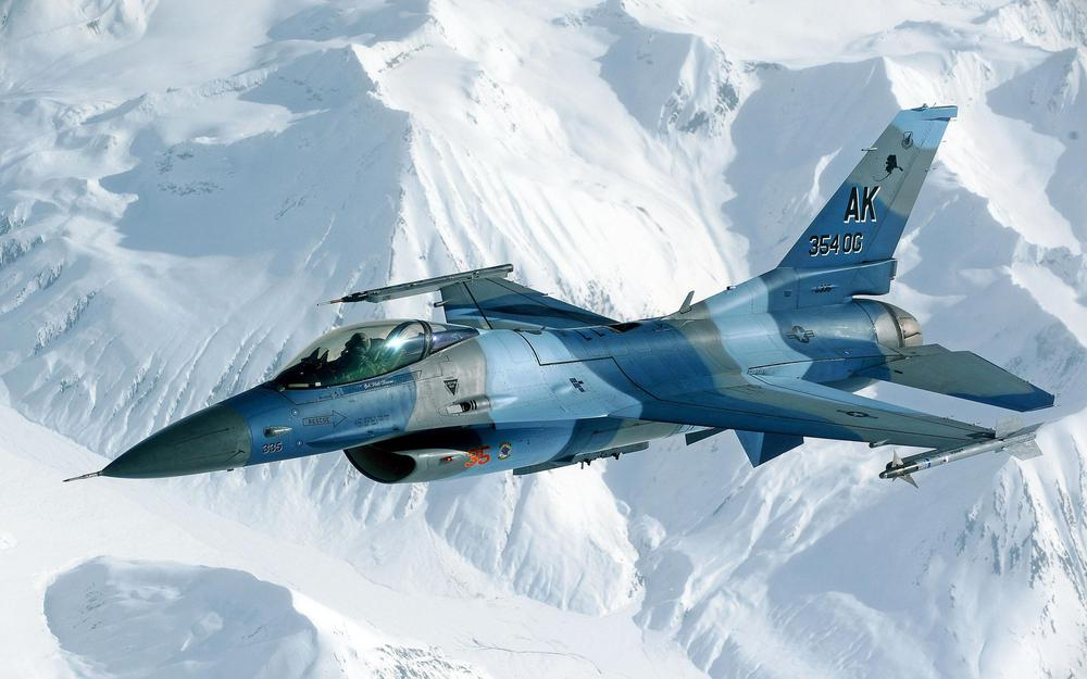 Fighter over snowy mountains hd wallpaper