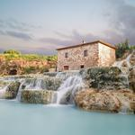 Stone house with a waterfall