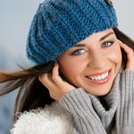 Brown-haired woman in a blue cap desktop wallpaper