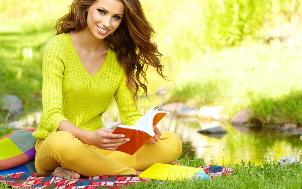 Girl reading a book in nature wallpaper