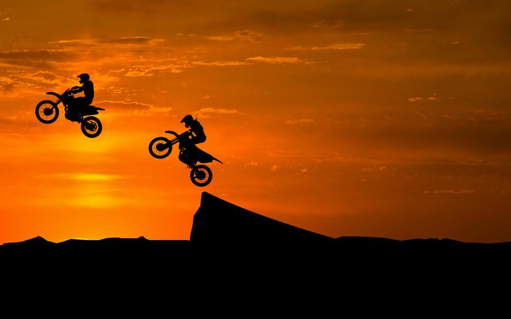 Silhouettes, motorcyclist, trick