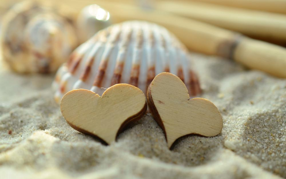 Sand, heart, shell wallpaper