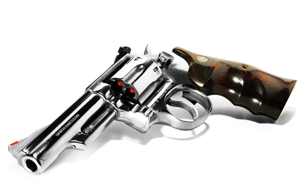 Revolver with red bullets wallpaper
