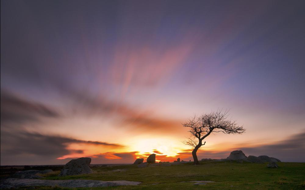 Sunset on the background of stones