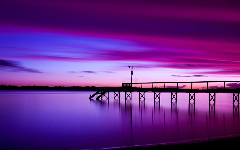 Pier against the background of a lilac sunset